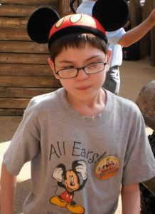 Image of Bobby at Disney from a family trip