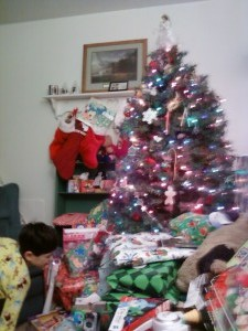 Special Needs at Christmas - Bobby peeking under the tree